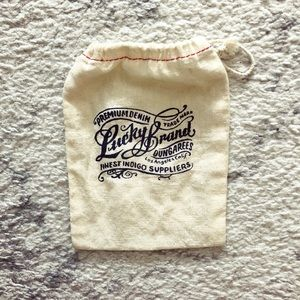 Cream-colored Lucky Brand jewelry dust bag